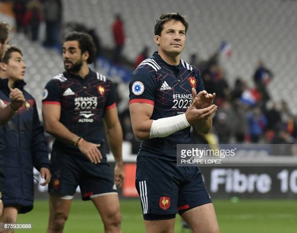France's flyhalf Francois TrinhDuc applauds supporters after the friendly rugby union international Test match between France and South Africa's...