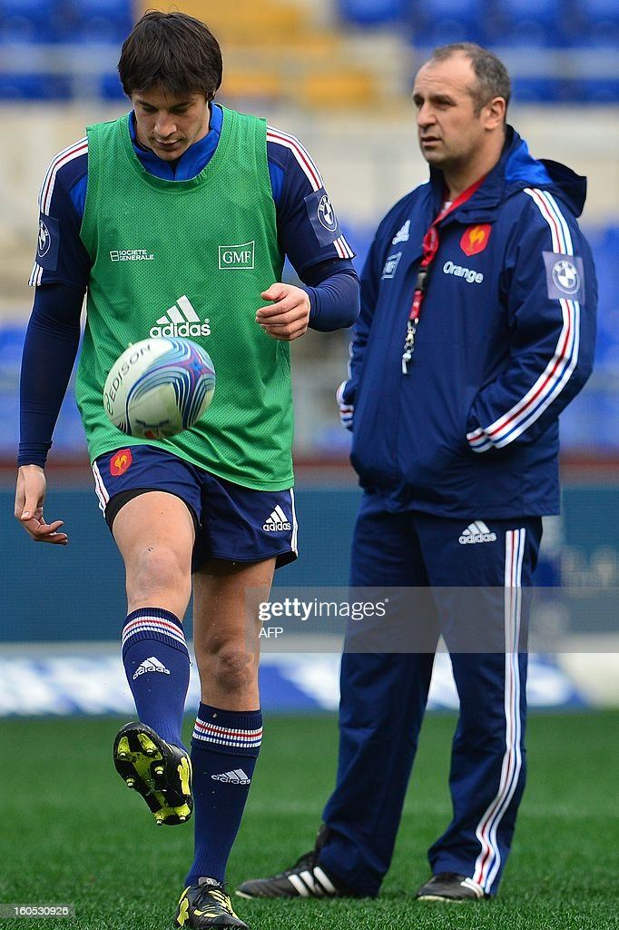 France's fly-half François Trinh-Duc and France's head coach Philippe Saint-André (R) react during the captain's run on the eve of the Six Nations International Rugby Union match between Italy and France at the Olympic Stadium in Rome on February 2, 2013.