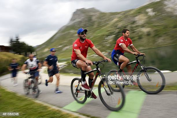France's flyhalf Frederic Michalak and scrumhalf Sebastien TillousBorde take part in a 'Run and Bike' session as part of the French rugby union...