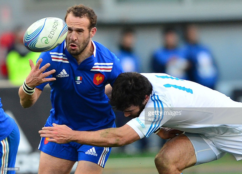 France's fly-half Frederic Michalak is tackled by Italy's winger Luke McLean (R) during the Six Nations international rugby union match Italy vs France in Rome's Olimpic Stadium on February 3, 2013. Italy defeated France 23-18. AFP PHOTO / GABRIEL BOUYS