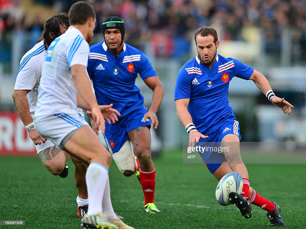 France's fly-half Frederic Michalak (R) kicks the ball during the Six Nations International Rugby Union match between Italy and France at the Olympic Stadium in Rome on February 3, 2013.