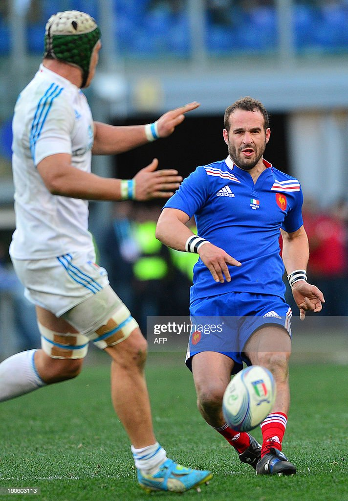 France's fly-half Frederic Michalak (R) kicks the ball during the Six Nations international rugby union match Italy vs France in Rome's Olimpic Stadium on February 3, 2013. Italy defeated France 23-18.