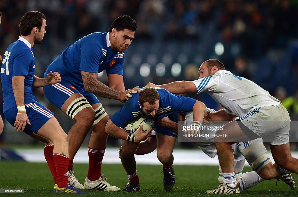 France's fly-half Frederic Michalak (C) vies with Italy's kooker Davide Giazzon during the Six Nations international rugby union match Italy vs France in Rome's Olimpic Stadium on February 3, 2013. Italy defeated France 23-18.