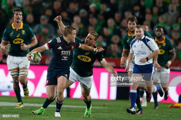 France's flyhalf Jules Plisson attempts to avoid a tackle during the third rugby union Test match between South Africa and France at The Emirates...