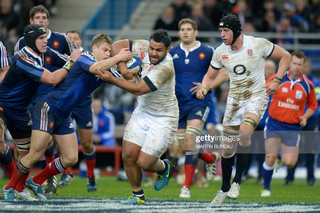 France's fly-half Jules Plisson (2nd L) grabs onto England's number 8 Billy Vunipola (C) during the Six Nations rugby union match between France and England on February 1, 2014 at the Stade de France in Saint-Denis, north of Paris.