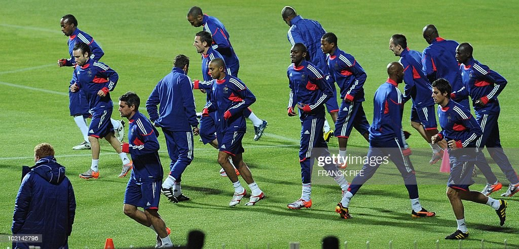 France's football national team runs during a training session on the warming pitch of the Peter Mokaba stadium in Polokwane, on June 16, 2010. France will play against Mexico in their second first-round match on June 17.