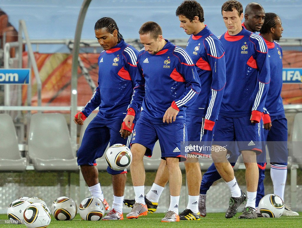 France's football national team's midfielder Florent Malouda, Franck Ribery, Yoann Gourcuff, and Anthony Reveillere take part in a training session at the Peter Mokaba stadium in Polokwane, on June 16, 2010. France will play against Mexico in their second first-round match of the 2010 Football World Cup on June 17.