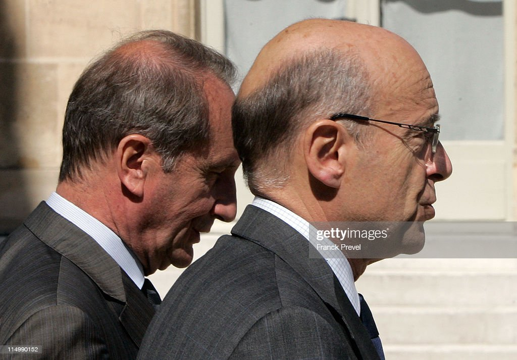 France's Foreign Affairs Minister <a gi-track='captionPersonalityLinkClicked' href=/galleries/search?phrase=Alain+Juppe&family=editorial&specificpeople=235359 ng-click='$event.stopPropagation()'>Alain Juppe</a> (R) and Defence and Veterans minister <a gi-track='captionPersonalityLinkClicked' href=/galleries/search?phrase=Gerard+Longuet&family=editorial&specificpeople=2528102 ng-click='$event.stopPropagation()'>Gerard Longuet</a> leave the weekly cabinet meeting at Elysee Palace on June 1, 2011 in Paris, France.