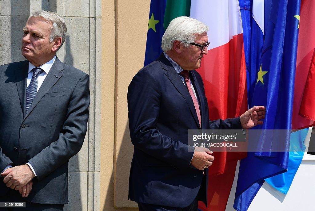 France's Foreign minister Jean-Marc Ayrault (L) and Germany's Foreign minister Frank-Walter Steinmeier attend a press conference after talks at the Villa Borsig in Berlin on June 25, 2016. The EU's founding states said they want Britain to begin leaving the union 'as soon as possible', as France urged a new British prime minister to take office quickly. / AFP / John MACDOUGALL