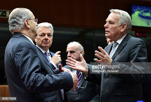 France's Foreign Minister JeanMarc Ayrault Belgium's Foreign Minister Didier Reynders and Cyprus' Foreign Minister Loannis Kasoulides attend a EU...