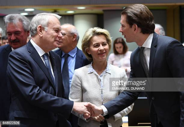 France's Foreign Minister JeanMarc Ayrault German Defence Minister Ursula von der Leyen and Austria's Foreign Minister Sebastian Kurz talk as they...