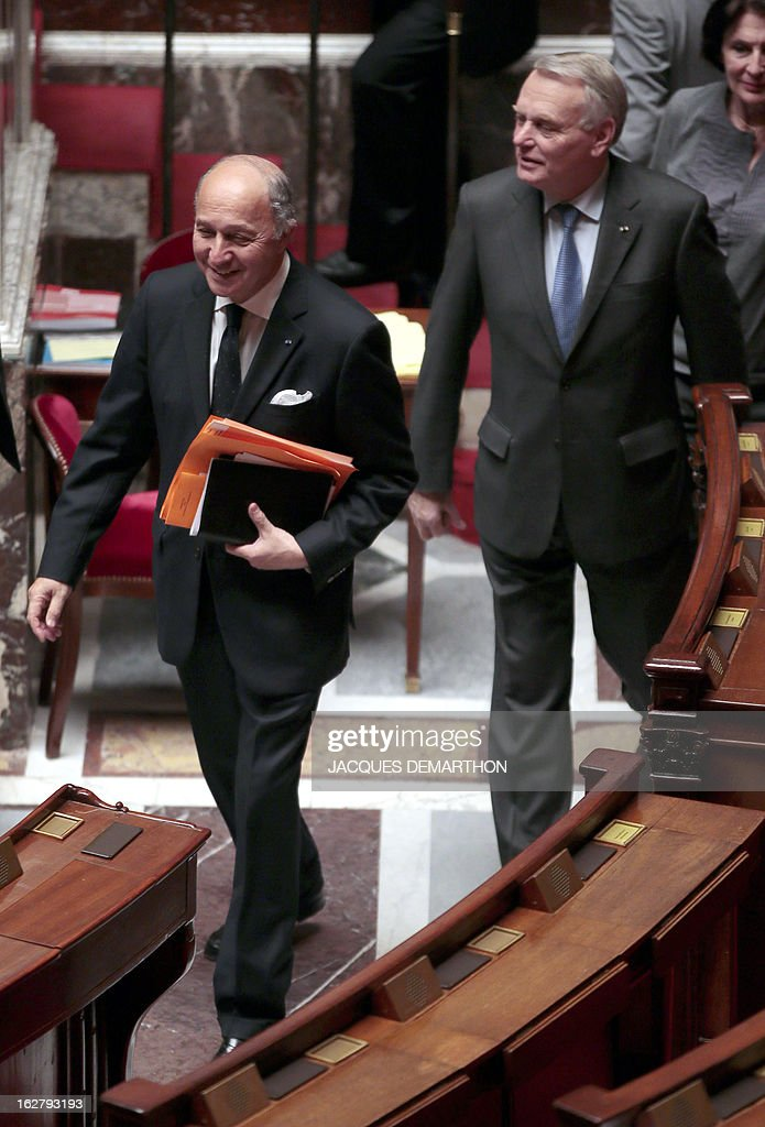 France's Foreign Minister Laurent Fabius (L) and Prime Minister Jean-Marc Ayrault (R) arrive for a debate on Mali, on February 27, 2013 at the National Assembly in Paris.
