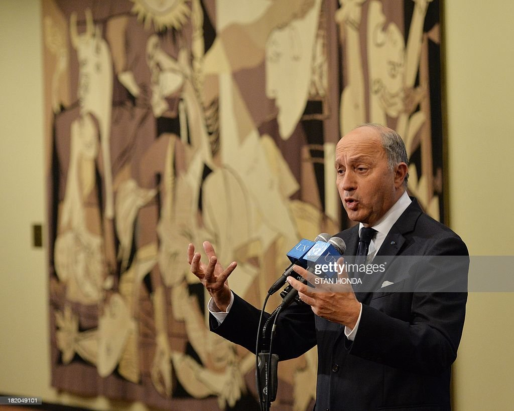 France's Foreign Minister Laurent Fabius speaks to the media outside the United Nations Security Council just after the Council voted to approve a resolution that will require Syria to give up its chemical weapons during a meeting September 27, 2013 at UN headquarters in New York. AFP PHOTO/Stan HONDA