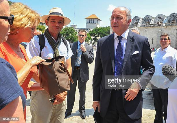 France's Foreign Minister Laurent Fabius talks with tourists in Havana on April 12 2014 Fabius is in Cuba in official visit AFP PHOTO/YAMIL LAGE