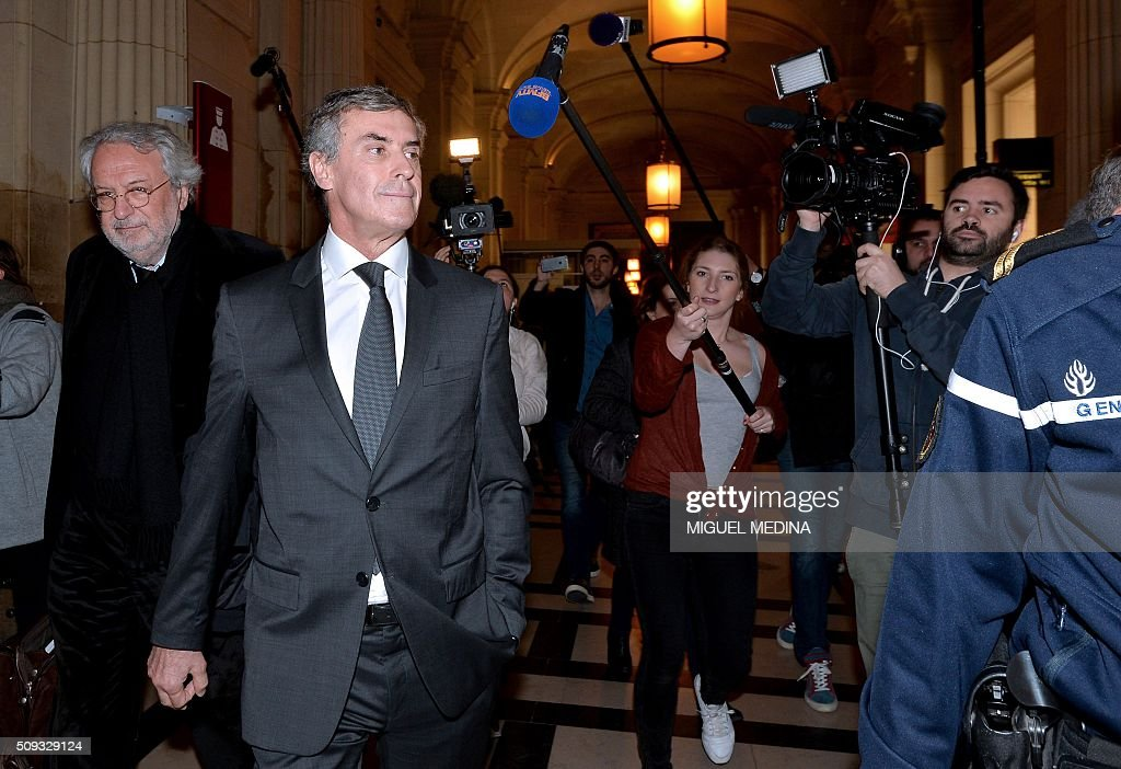 France's former budget minister Jerome Cahuzac (C), and one of his lawyers Jean-Alain Michel (L) leave the Paris courthouse after Cahuzac's tax fraud trial was adjourned to a later date on a technical legal question, on its second day on February 10, 2016. Cahuzac, who stashed millions abroad while cracking down on tax cheats at home, went on trial on February 9 for tax fraud and money laundering. His trial was adjourned to September 5, 2016 after his lawyers argued that Cahuzac has already settled his debts with the tax authorities and should not be tried twice over the same matter. / AFP / MIGUEL MEDINA