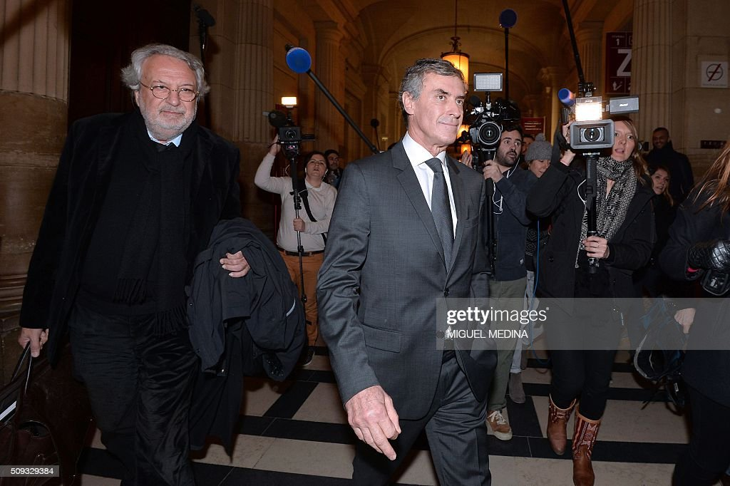 France's former budget minister Jerome Cahuzac (C) and one of his lawyers Jean-Alain Michel (L) leave the Paris courthouse after Cahuzac's tax fraud trial was adjourned to a later date on a technical legal question, on its second day on February 10, 2016. France's former budget minister Jerome Cahuzac, who stashed millions abroad while cracking down on tax cheats at home, went on trial on February 9 for tax fraud and money laundering. His trial was adjourned to September 5, 2016 after his lawyers argued that Cahuzac has already settled his debts with the tax authorities and should not be tried twice over the same matter. / AFP / MIGUEL MEDINA