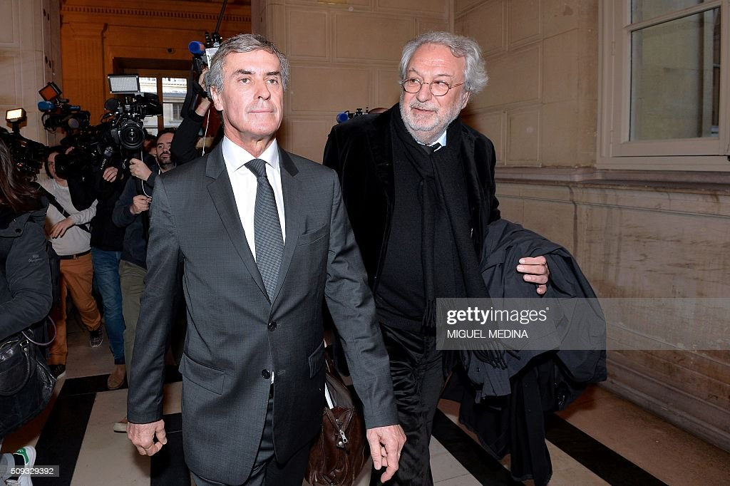 France's former budget minister Jerome Cahuzac (C) and one of his lawyers Jean-Alain Michel leave the Paris courthouse after Cahuzac's tax fraud trial was adjourned to a later date on a technical legal question, on its second day on February 10, 2016. France's former budget minister Jerome Cahuzac, who stashed millions abroad while cracking down on tax cheats at home, went on trial on February 9 for tax fraud and money laundering. His trial was adjourned to September 5, 2016 after his lawyers argued that Cahuzac has already settled his debts with the tax authorities and should not be tried twice over the same matter. / AFP / MIGUEL MEDINA
