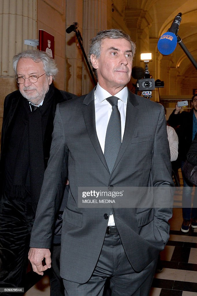 France's former budget minister Jerome Cahuzac (R) and one of his lawyers Jean-Alain Michel leave the Paris courthouse after Cahuzac's tax fraud trial was adjourned to a later date on a technical legal question, on its second day on February 10, 2016. France's former budget minister Jerome Cahuzac, who stashed millions abroad while cracking down on tax cheats at home, went on trial on February 9 for tax fraud and money laundering. His trial was adjourned to September 5, 2016 after his lawyers argued that Cahuzac has already settled his debts with the tax authorities and should not be tried twice over the same matter. / AFP / MIGUEL MEDINA