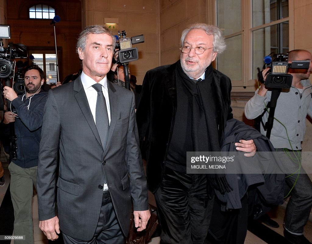 France's former budget minister Jerome Cahuzac (L) and one of his lawyers Jean-Alain Michel (C) leave the Paris courthouse after Cahuzac's tax fraud trial was adjourned to a later date on a technical legal question, on its second day on February 10, 2016. France's former budget minister Jerome Cahuzac, who stashed millions abroad while cracking down on tax cheats at home, went on trial on February 9 for tax fraud and money laundering. His trial was adjourned to September 5, 2016 after his lawyers argued that Cahuzac has already settled his debts with the tax authorities and should not be tried twice over the same matter. / AFP / MIGUEL MEDINA