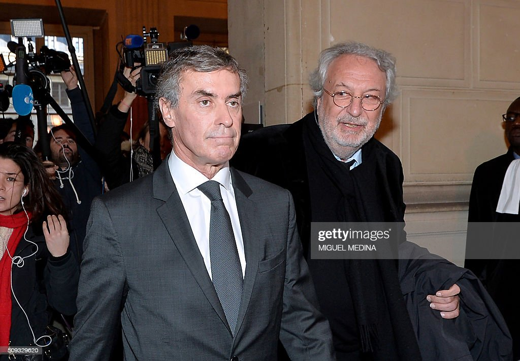 France's former budget minister Jerome Cahuzac (L) and one of his lawyers Jean-Alain Michel leave the Paris courthouse after Cahuzac's tax fraud trial was adjourned to a later date on a technical legal question, on its second day on February 10, 2016. France's former budget minister Jerome Cahuzac, who stashed millions abroad while cracking down on tax cheats at home, went on trial on February 9 for tax fraud and money laundering. His trial was adjourned to September 5, 2016 after his lawyers argued that Cahuzac has already settled his debts with the tax authorities and should not be tried twice over the same matter. / AFP / MIGUEL MEDINA