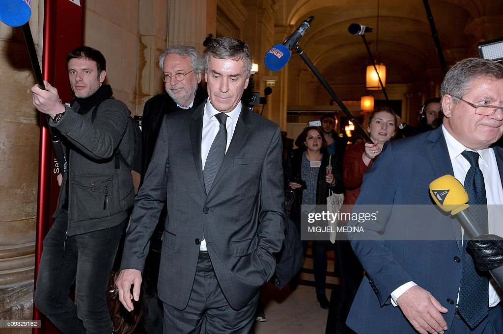 France's former budget minister Jerome Cahuzac (C), and two of his lawyers Jean-Alain Michel (L) and Jean Veil (R) leave the Paris courthouse after Cahuzac's tax fraud trial was adjourned to a later date on a technical legal question, on its second day on February 10, 2016. Cahuzac, who stashed millions abroad while cracking down on tax cheats at home, went on trial on February 9 for tax fraud and money laundering. His trial was adjourned to September 5, 2016 after his lawyers argued that Cahuzac has already settled his debts with the tax authorities and should not be tried twice over the same matter. / AFP / MIGUEL MEDINA