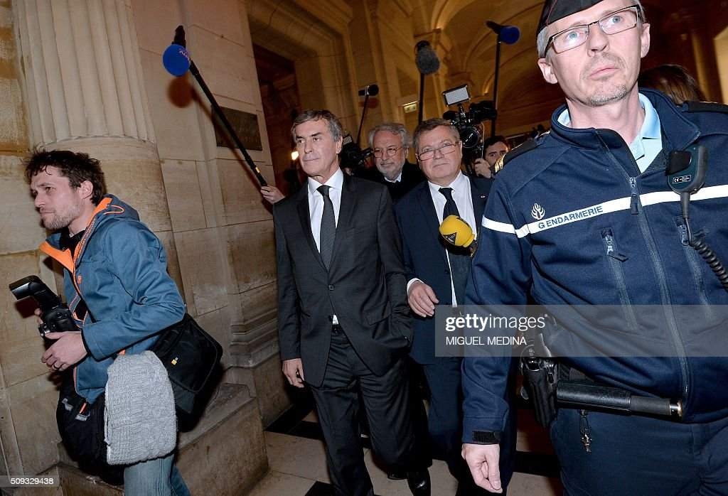 France's former budget minister Jerome Cahuzac (2nd L) and two of his lawyers Jean-Alain Michel (Rear C) and Jean Veil (2nd R) leave the Paris courthouse after Cahuzac's tax fraud trial was adjourned to a later date on a technical legal question, on its second day on February 10, 2016. France's former budget minister Jerome Cahuzac, who stashed millions abroad while cracking down on tax cheats at home, went on trial on February 9 for tax fraud and money laundering. His trial was adjourned to September 5, 2016 after his lawyers argued that Cahuzac has already settled his debts with the tax authorities and should not be tried twice over the same matter. / AFP / MIGUEL MEDINA
