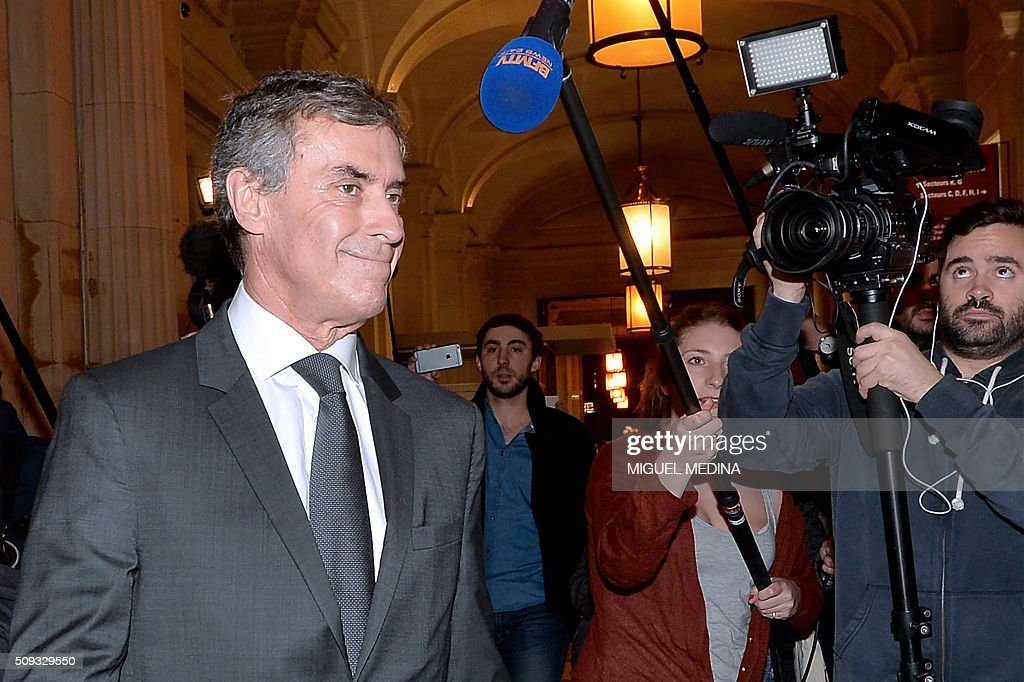 France's former budget minister Jerome Cahuzac (L) leaves the Paris courthouse after Cahuzac's tax fraud trial was adjourned to a later date on a technical legal question, on its second day on February 10, 2016. France's former budget minister Jerome Cahuzac, who stashed millions abroad while cracking down on tax cheats at home, went on trial on February 9 for tax fraud and money laundering. His trial was adjourned to September 5, 2016 after his lawyers argued that Cahuzac has already settled his debts with the tax authorities and should not be tried twice over the same matter. / AFP / MIGUEL MEDINA