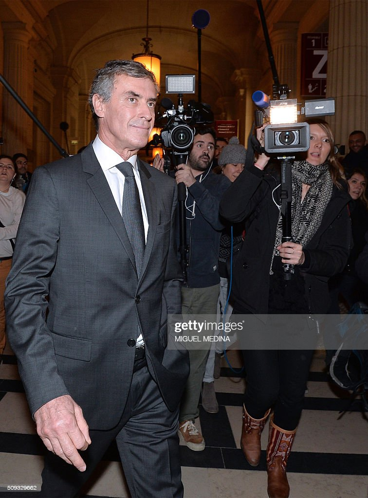 France's former budget minister Jerome Cahuzac (L) leaves the Paris courthouse after his tax fraud trial was adjourned to a later date on a technical legal question, on its second day on February 10, 2016. France's former budget minister Jerome Cahuzac, who stashed millions abroad while cracking down on tax cheats at home, went on trial on February 9 for tax fraud and money laundering. His trial was adjourned to September 5, 2016 after his lawyers argued that Cahuzac has already settled his debts with the tax authorities and should not be tried twice over the same matter. / AFP / MIGUEL MEDINA