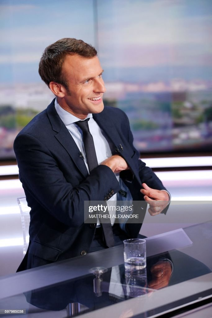 France's former Minister of the Economy Emmanuel Macron gestures before taking part in the broadcast news of the French television channel TF1 in...
