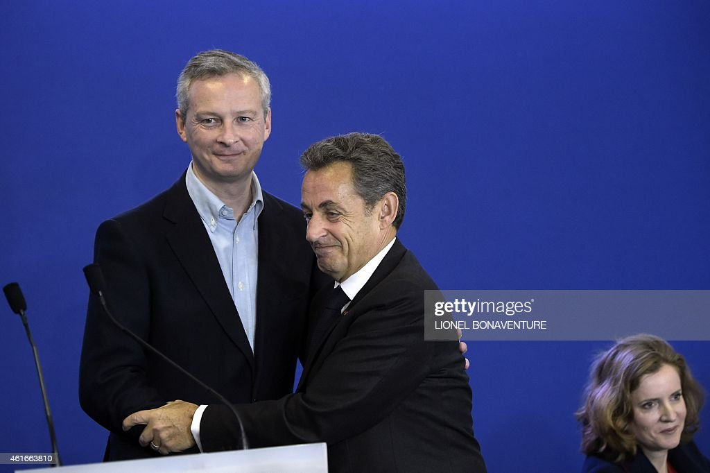 France's former President and leader of the right-wing UMP party <a gi-track='captionPersonalityLinkClicked' href=/galleries/search?phrase=Nicolas+Sarkozy&family=editorial&specificpeople=211375 ng-click='$event.stopPropagation()'>Nicolas Sarkozy</a> (C), UMP vice-president <a gi-track='captionPersonalityLinkClicked' href=/galleries/search?phrase=Nathalie+Kosciusko-Morizet&family=editorial&specificpeople=2547835 ng-click='$event.stopPropagation()'>Nathalie Kosciusko-Morizet</a> (R), and UMP member of parliament <a gi-track='captionPersonalityLinkClicked' href=/galleries/search?phrase=Bruno+Le+Maire&family=editorial&specificpeople=877418 ng-click='$event.stopPropagation()'>Bruno Le Maire</a> attend a meeting to welcome right-wing UMP party's new members on January 17, 2015 at the UMP headquarters in Paris.