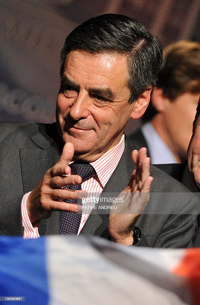 France's former Prime Minister Francois Fillon applauds on November 14, 2012 in Gradignan near Bordeaux, in southwestern France, during a public meeting as part of his campaign to take over the leadership of France's main right-wing opposition UMP party next November 18.