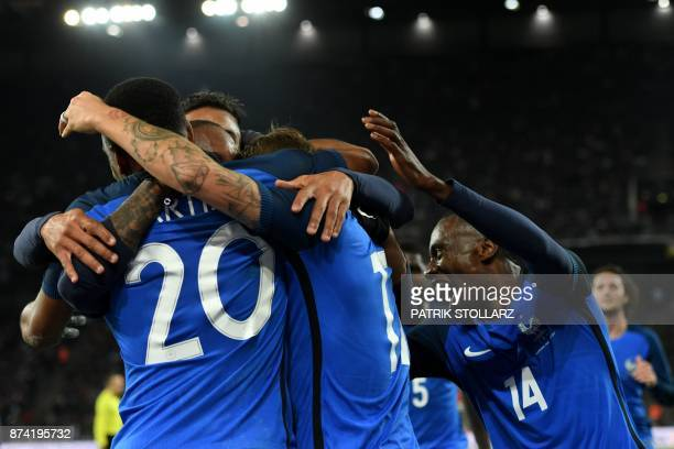 TOPSHOT France's forward Alexandre Lacazette is congratulated by teammates after he scored a goal during the international friendly football match...