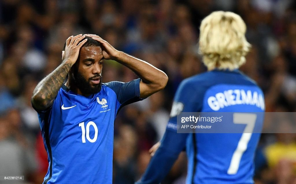 France's forward Alexandre Lacazette reacts after missing a shot on the goal during the FIFA World Cup 2018 qualifying football match France vs Luxembourg at The Municipal Stadium in Toulouse, southern France, on September 3, 2017. /