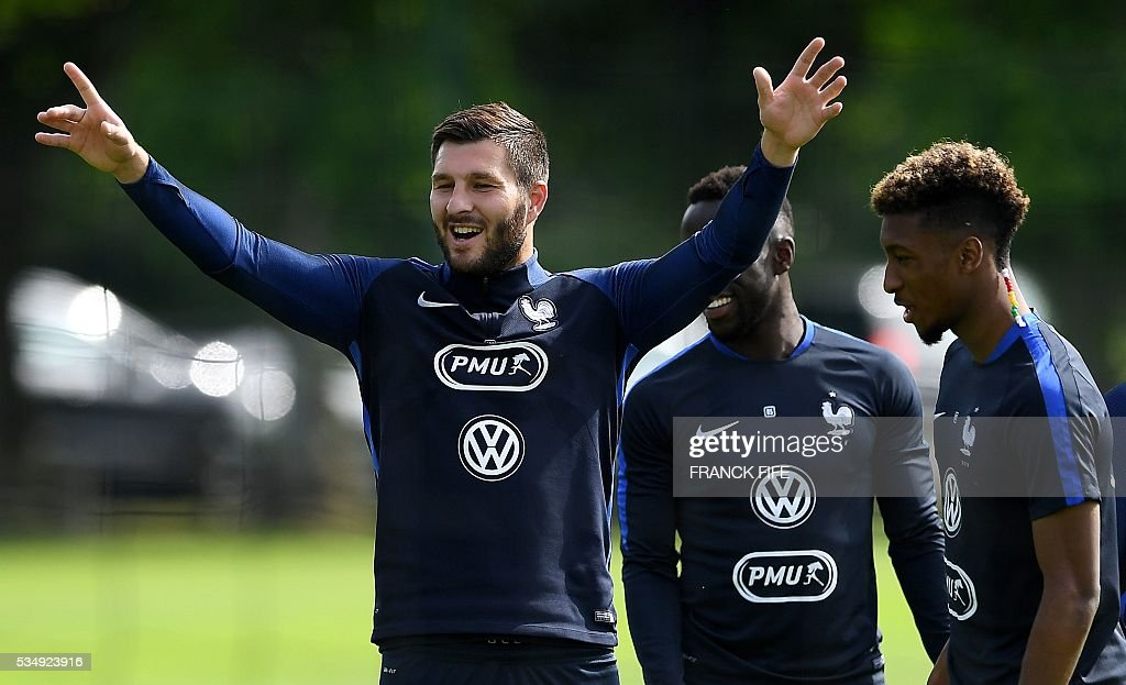 France's forward Andre Pierre Gignac gestures before a training session in Clairefontaine-en-Yvelines on May 28, 2016, as part of the team's preparation for the upcoming Euro 2016 European football championships. / AFP / FRANCK