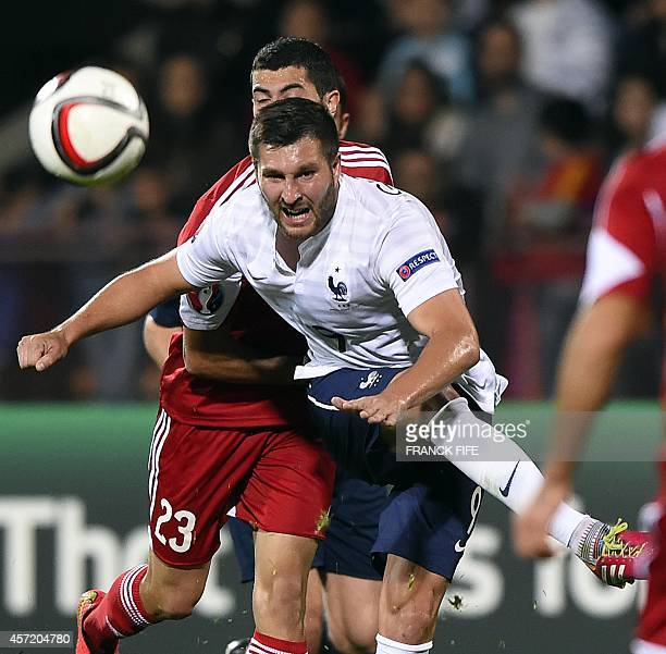 France's forward Andre Pierre Gignac kicks the ball past Armenia's midfielder Artem Simonian during a friendly football match between Armenia and...