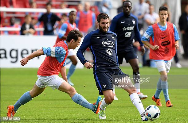 France's forward Andre Pierre Gignac passes the ball during a friendly match between French national football team and Bayonne at the Aguilera...