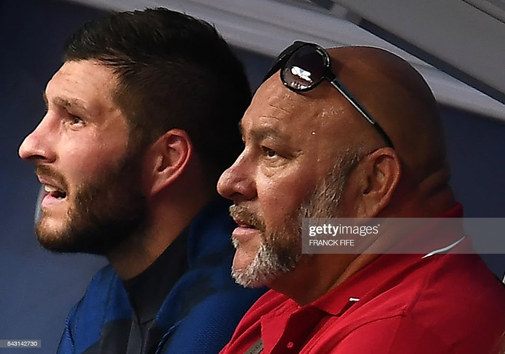France's forward Andre-Pierre Gignac (L) reacts next to his father Gerald after winning the Euro 2016 round of 16 football match between France and Republic of Ireland at the Parc Olympique Lyonnais stadium in Decines-Charpieu, near Lyon, on June 26, 2016. / AFP / FRANCK