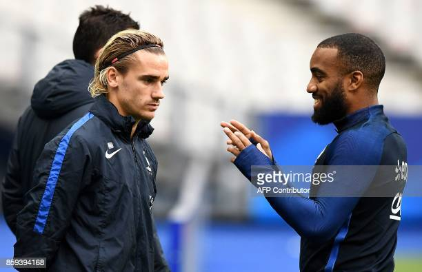 France's forward Antoine Griezmann and France's forward Alexandre Lacazette attend a training session at the Stade de France stadium in SaintDenis...