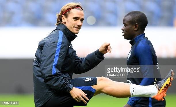France's forward Antoine Griezmann and France's midfielder N'Golo Kante attend in a training session at the Friends Arena in Solna on June 8 on the...