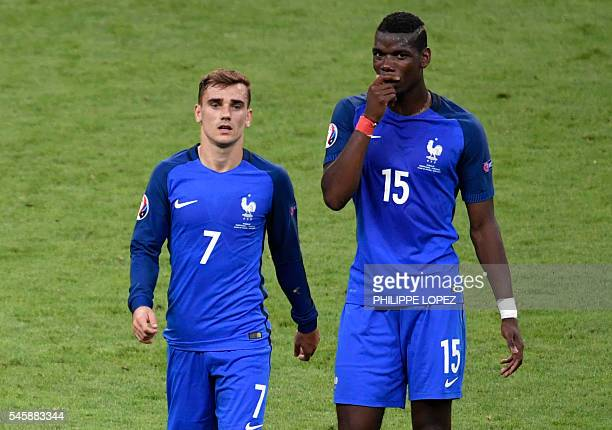 France's forward Antoine Griezmann and France's midfielder Paul Pogba speak as they leave the pitch after halftime during the Euro 2016 final...
