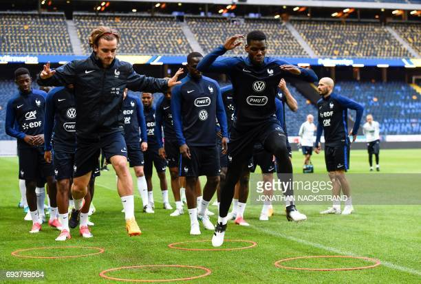 France's forward Antoine Griezmann and midfielder Paul Pogba attend a training session of the French national football team on the eve of the WC 2018...