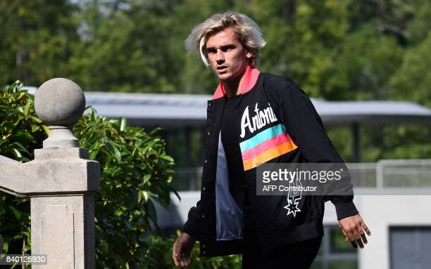 France's forward Antoine Griezmann arrives at the French national football team training base in Clairefontaine on August 28 as part of the team's...