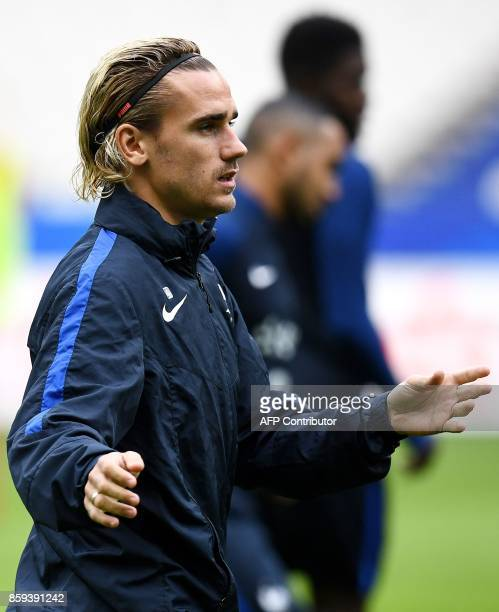 France's forward Antoine Griezmann attends a training session at the Stade de France stadium in SaintDenis north of Paris on the eve of the team's...