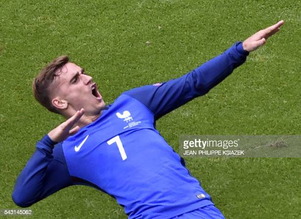 France's forward Antoine Griezmann celebrates after scoring a goal during the Euro 2016 round of 16 football match between France and Republic of...