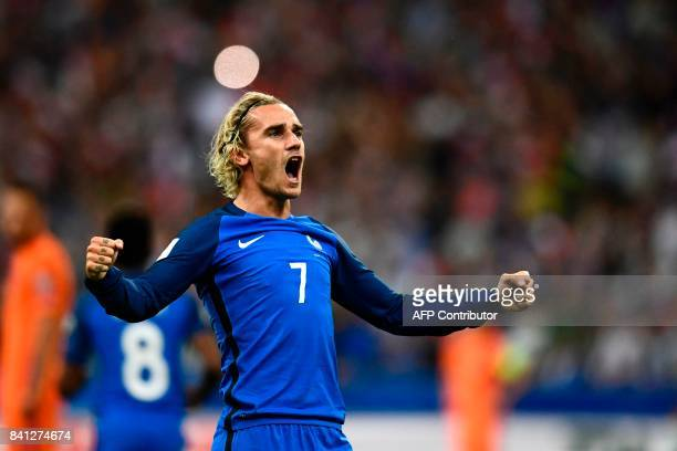 France's forward Antoine Griezmann celebrates after scoring a goal during the 2018 FIFA World Cup qualifying football match France vs Netherlands at...