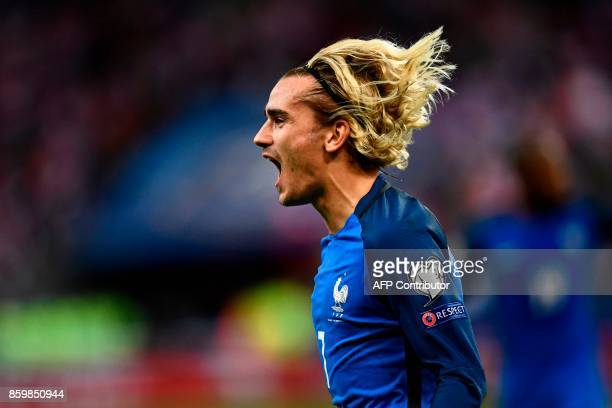 TOPSHOT France's forward Antoine Griezmann celebrates after scoring a goal during the FIFA World Cup 2018 qualification football match between France...
