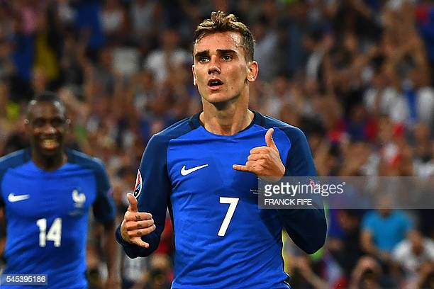 France's forward Antoine Griezmann celebrates after scoring the second goal for France during the Euro 2016 semifinal football match between Germany...