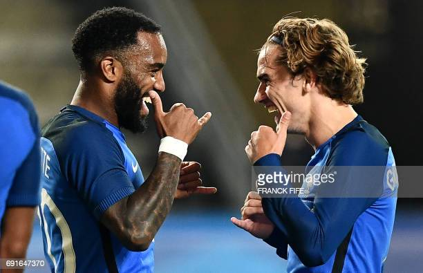 France's forward Antoine Griezmann celebrates his goal with France's forward Alexandre Lacazette during the friendly football match France vs...