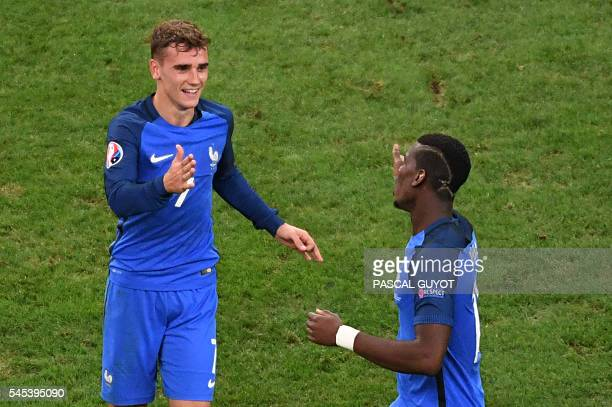 France's forward Antoine Griezmann celebrates scoring a goal with France's midfielder Paul Pogba during the Euro 2016 semifinal football match...