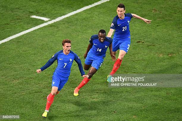 France's forward Antoine Griezmann celebrates with France's midfielder Blaise Matuidi and France's defender Laurent Koscielny after scoring during...